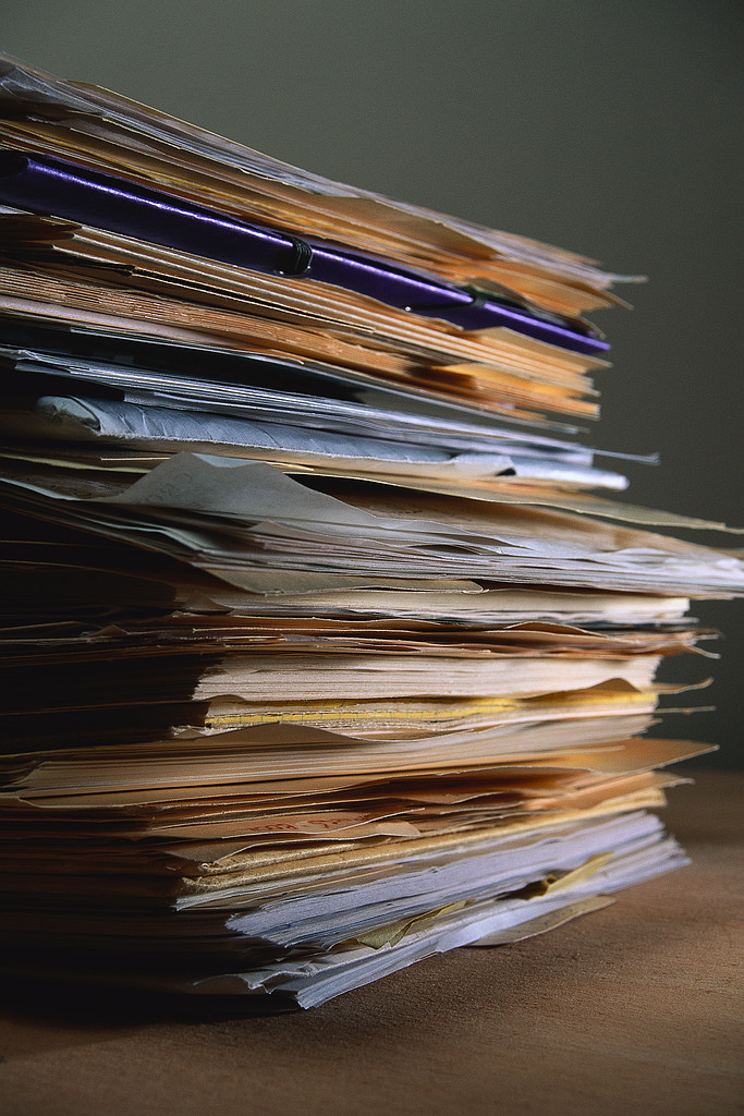 A pile of papers requiring filing.