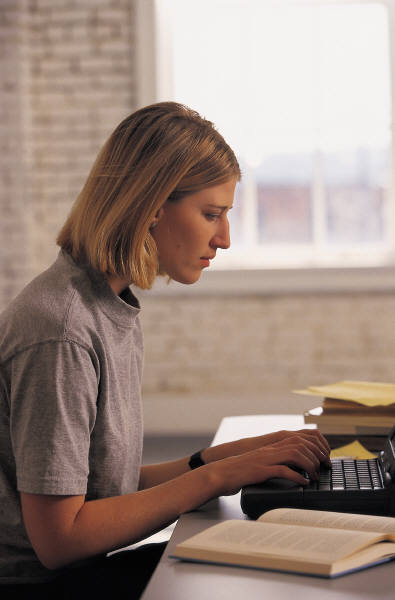 The woman now begins to type at a keyboard and looks inspired